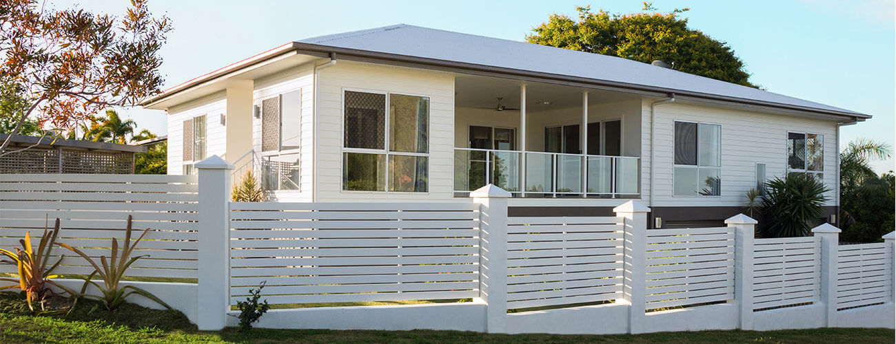 New Home with white timber slat fence